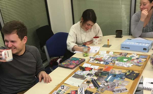 The team working on mood boards as part of the rebrand process.
